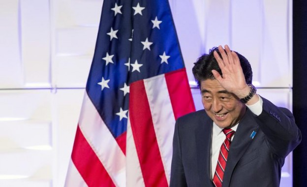 Japan's Prime Minister Abe waves after speaking at a luncheon in Los Angeles
