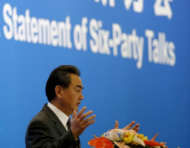 Chinese Foreign Minister Wang Yi delivers a speech during the international seminar commemorating the 10th anniversary of the September 19 joint statement of six-party talks at the Diaoyutai State Guesthouse in Beijing, China, September 19, 2015. In 2005, North Korea reached an agreement with the United States, South Korea, China, Japan and Russia to suspend its nuclear program in return for diplomatic rewards and energy assistance. REUTERS/Kim Kyung-Hoon