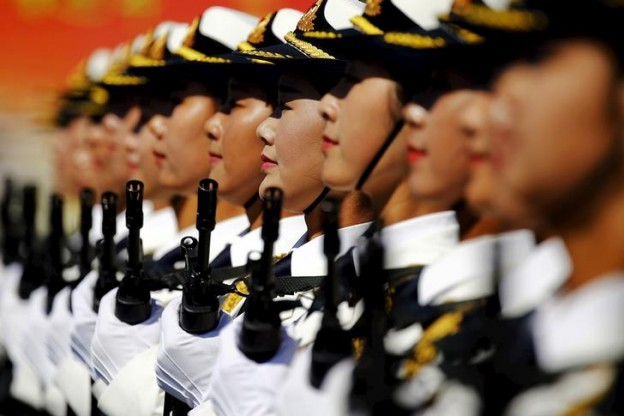 Soldiers of China's People's Liberation Army march with their weapons during a training session for a military parade to mark the 70th anniversary of the end of the World War Two, at a military base in Beijing, China, August 22, 2015. Troops from at least 10 countries including Russia and Kazakhstan will join an unprecedented military parade in Beijing next month to commemorate China's victory over Japan during World War Two, Chinese officials said. The parade on Sept. 3 will involve about 12,000 Chinese troops and 200 aircraft, Qi Rui, deputy director of the government office organizing the parade, told reporters in Beijing on Friday. REUTERS/Damir Sagolj