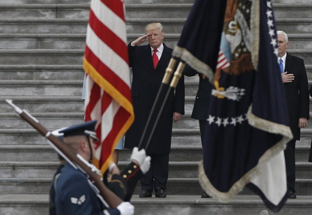 Newly inaugurated U.S. President Donald Trump salutes as he presides over a military parade during Trump's swearing ceremony in Washington, U.S., January 20, 2017.   REUTERS/Mike Segar  - RTSWKSW