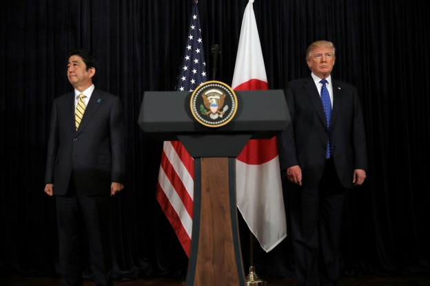 U.S. President Donald Trump and Japanese Prime Minister Shinzo Abe leave after delivering remarks on North Korea at Mar-a-Lago club in Palm Beach, Florida U.S., February 11, 2017. REUTERS/Carlos Barria - RTSY8HL
