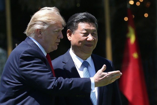 U.S. President Donald Trump and China's President Xi Jinping chat as they walk along the front patio of the Mar-a-Lago estate after a bilateral meeting in Palm Beach, Florida, U.S., April 7, 2017. REUTERS/Carlos Barria - RTX34M80