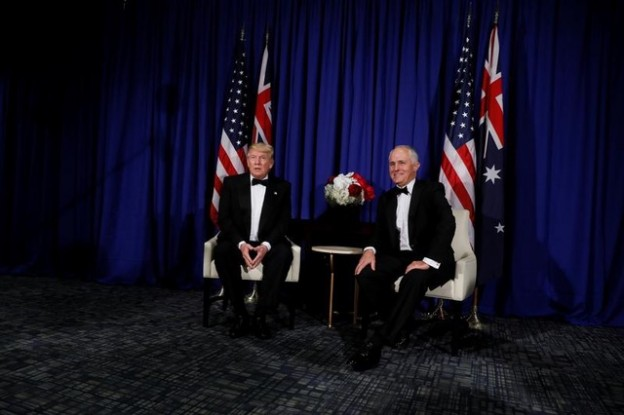 U.S. President Donald Trump (L) and Australia's Prime Minister Malcolm Turnbull (R) deliver brief remarks to reporters as they meet ahead of an event commemorating the 75th anniversary of the Battle of the Coral Sea, aboard the USS Intrepid Sea, Air and Space Museum in New York, U.S. May 4, 2017. REUTERS/Jonathan Ernst - RTS158D6