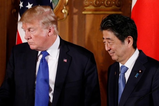U.S. President Donald Trump and Japan's Prime Minister Shinzo Abe depart at the end of a news conference at Akasaka Palace in Tokyo, Japan, November 6, 2017. REUTERS/Jonathan Ernst - RC1D6FF95B30