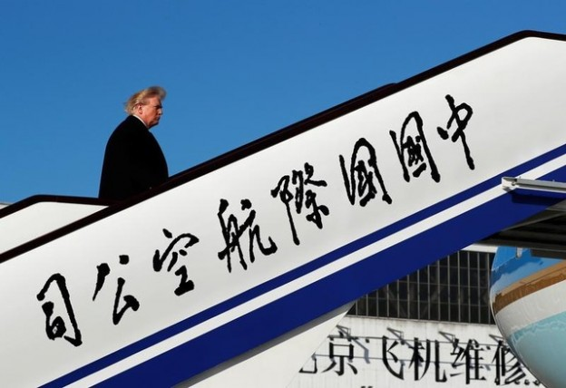 U.S. President Donald Trump boards Air Force One to depart for Vietnam from Beijing Airport in Beijing, China, November 10, 2017. REUTERS/Jonathan Ernst - RC1BEE0CF800