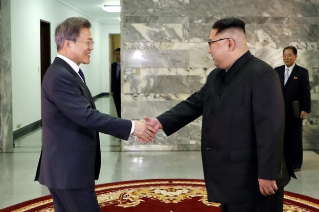 South Korean President Moon Jae-in is greeted by North Korean leader Kim Jong Un during their summit at the truce village of Panmunjom, North Korea, in this handout picture provided by the Presidential Blue House on May 26, 2018. Picture taken on May 26, 2018.     The Presidential Blue House /Handout via REUTERS ATTENTION EDITORS - THIS IMAGE WAS PROVIDED BY A THIRD PARTY - RC15570BB490