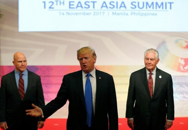 U.S. President Donald Trump gestures with both hands as he talks about his 12-day Asian tour that brought him to five countries in Asia, with the final stop in the Philippines for 31st ASEAN Summit Tuesday, November 14, 2017 in Manila, Philippines. At left is National Security Advisor H.R. McMaster and at right is State Secretary Rex Tillerson.   REUTERS/Bullit Marquez/Pool - RC1AE99E06C0