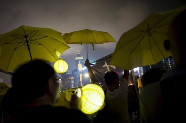 Pro-democracy protesters rise their yellow umbrellas, the symbol of the Occupy Central movement, as they march to the government headquarters two days before the first anniversary of the Occupy Central civil disobedience movement, in Hong Kong, China September 26, 2015. REUTERS/Tyrone Siu       TPX IMAGES OF THE DAY      - GF10000221829