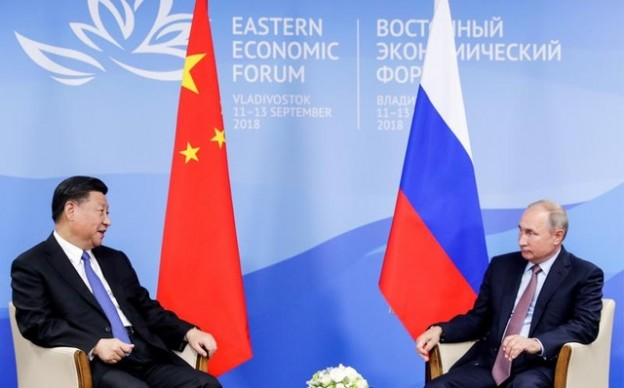 Chinese President Xi Jinping speaks with Russian President Vladimir Putin during their meeting on the sidelines of the Eastern Economic Forum in Vladivostok, Russia September 11, 2018. Mikhail Metzel/TASS Host Photo Agency/Pool via REUTERS - RC11C6B000B0