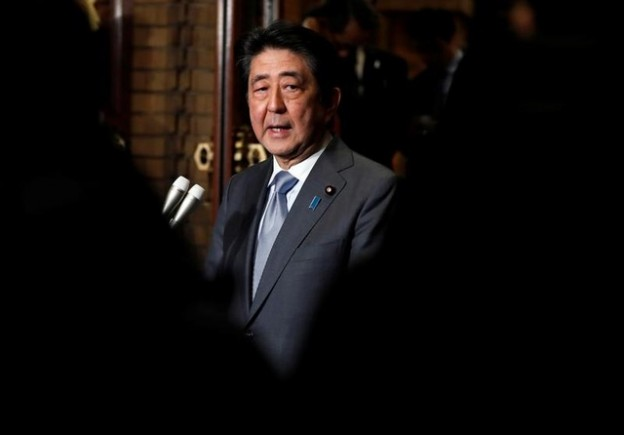 Japan's Prime Minister Shinzo Abe speaks to media after phone talks with U.S. President Donald Trump (not pictured) after second North Korea-U.S. summit, at Abe's residence in Tokyo, Japan February 28, 2019. REUTERS/Issei Kato - RC1ECE3BCD60