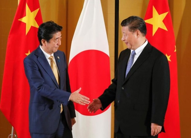 Chinese President Xi Jinping and Japanese Prime Minister Shinzo Abe show their hands for a handshaking at the start of talks at a hotel prior to the G20 Summit at the International Exhibition Center in Osaka, western Japan, June 27, 2019. Kimimasa Mayama/Pool via REUTERS - RC1625B27EB0