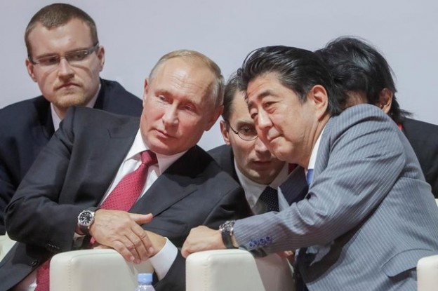 Russian President Vladimir Putin (L, 1st row) and Japanese Prime Minister Shinzo Abe (R, 1st row) attend an international judo tournament on the sidelines of the Eastern Economic Forum in Vladivostok, Russia September 12, 2018. Mikhail Metzel/TASS Host Photo Agency/Pool via REUTERS - RC149A59C230