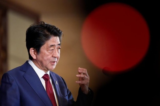 Japan's Prime Minister Shinzo Abe answers questions at a news conference at the 8th trilateral leaders' meeting between China, South Korea and Japan in Chengdu, Sichuan province, China December 24, 2019. Wang Zhao/Pool via REUTERS - RC2M1E9UISKD