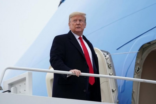 U.S. President Donald Trump and first lady Melania Trump depart Joint Base Andrews in Maryland, U.S., January 13, 2020. REUTERS/Kevin Lamarque - RC29FE9F9BY2