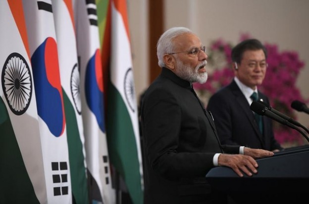 Indian Prime Minister Narendra Modi speaks as South Korea's President Moon Jae-in listens to during a joint press conference after their meeting at the presidential Blue House in Seoul on February 22, 2019. Jung Yeon-je/Pool via REUTERS - RC1DEAC748A0
