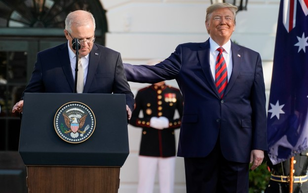 U.S. President Donald Trump pats Australia's Prime Minister Scott Morrison on the back as he speaks during an official arrival ceremony on the South Lawn of the White House in Washington, U.S., September 20, 2019. REUTERS/Joshua Roberts - RC174935A300