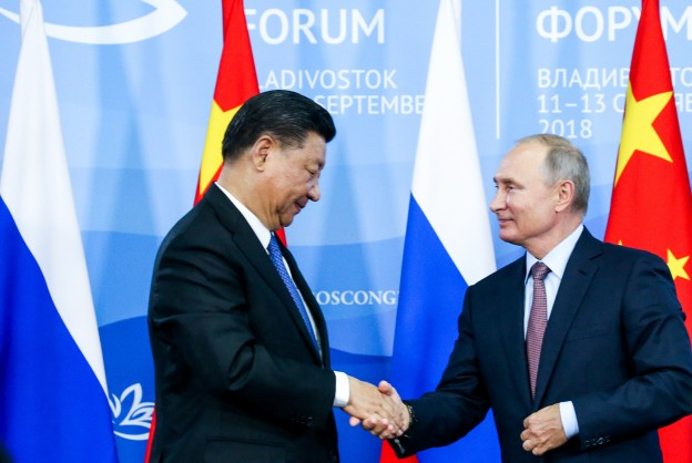 Chinese President Xi Jinping shakes hands with Russian President Vladimir Putin during a signing ceremony following the Russian-Chinese talks on the sidelines of the Eastern Economic Forum in Vladivostok, Russia September 11, 2018. Alexander Ryumin/TASS Host Photo Agency/Pool via REUTERS - RC1CCD778AD0