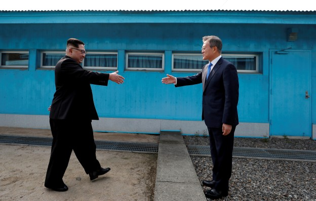 South Korean President Moon Jae-in and North Korean leader Kim Jong Un shake hands at the truce village of Panmunjom inside the demilitarized zone separating the two Koreas, South Korea, April 27, 2018.   Korea Summit Press Pool/Pool via Reuters     TPX IMAGES OF THE DAY - RC1BC18094E0