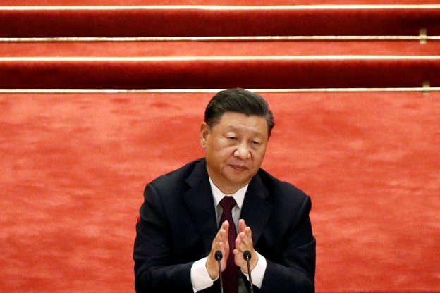 Chinese President Xi Jinping applauds during a meeting to commend role models in China's fight against the coronavirus disease (COVID-19) outbreak, at the Great Hall of the People in Beijing, China September 8, 2020. REUTERS/Carlos Garcia Rawlins - RC23UI9XUC48