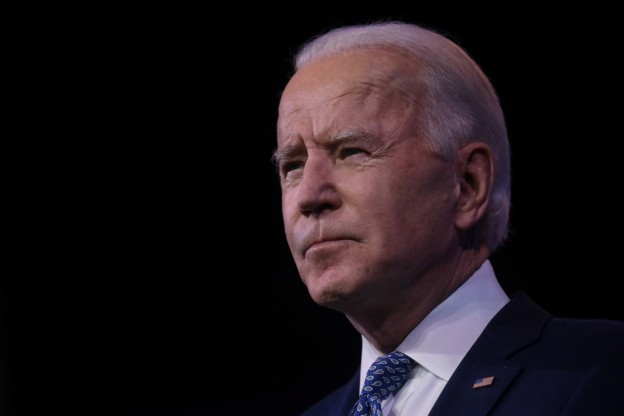 U.S. President-elect Joe Biden looks on as he speaks about the recent massive cyber attack against the U.S. and also other Biden administration goals in Wilmington, Delaware, U.S., December 22, 2020. REUTERS/Leah Millis - RC2KSK9NESLG
