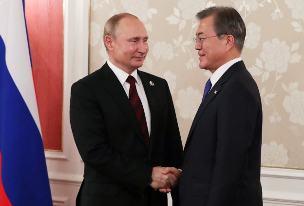 Russian President Vladimir Putin shakes hands with South Korean President Moon Jae-In during a meeting on the sidelines of the G20 summit in Osaka, Japan, June 28, 2019. Picture taken June 28, 2019. Sputnik/Mikhail Klimentyev/Kremlin via REUTERS ATTENTION EDITORS - THIS IMAGE WAS PROVIDED BY A THIRD PARTY. - RC1A89096FD0