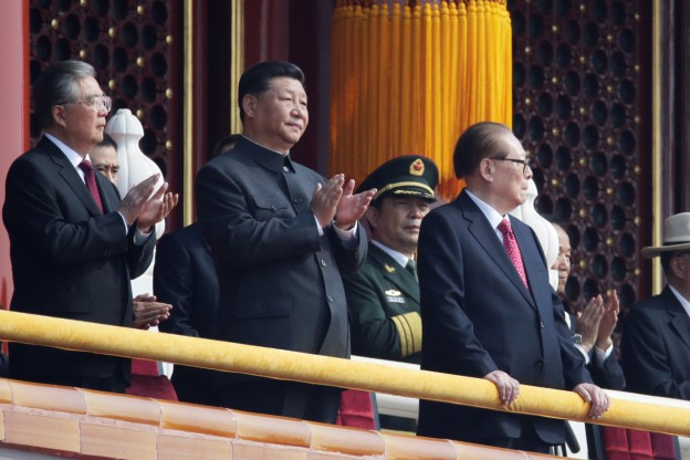 Chinese President Xi Jinping applauds as he stands between former presidents Hu Jintao and Jiang Zemin on Tiananmen Gate before the military parade marking the 70th founding anniversary of People's Republic of China, on its National Day in Beijing, China October 1, 2019. REUTERS/Jason Lee - SP1EFA1063B09