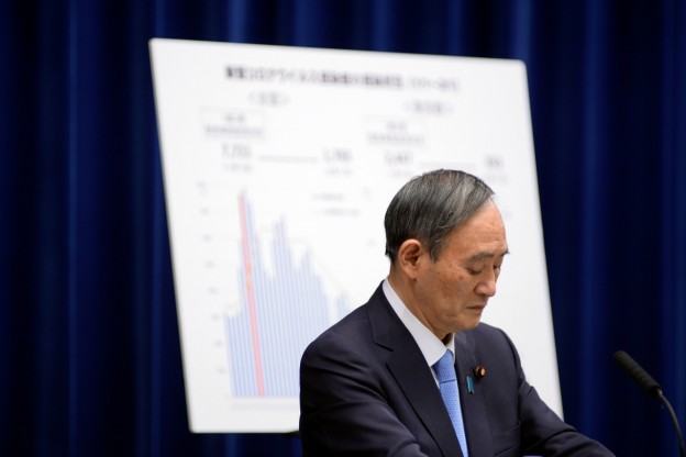 Japan's Prime Minister Yoshihide Suga addresses a news conference on the coronavirus disease (COVID-19) situation at the prime minister's official residence in Tokyo, Japan February 2, 2021. David Mareuil/Pool via REUTERS - RC2CKL9MKN7C